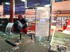 PHOTO: A man leaves a QuikTrip store in Ferguson, Mo., Aug. 10, 2014. The store was overrun by looters during protests for Michael Brown, 18, who was shot to death by police.