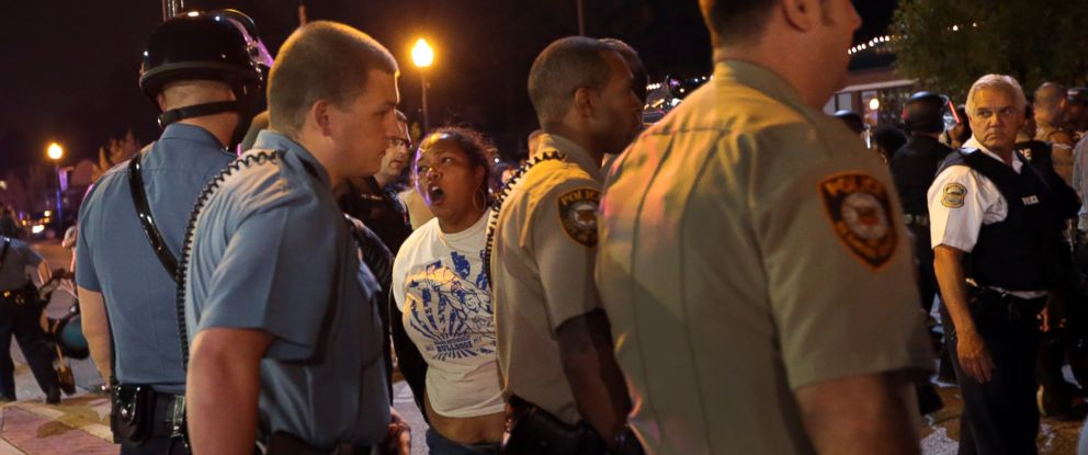 A woman is arrested by police officers in front of the Ferguson Police Department, on Thursday, Sept. 25, 2014.
