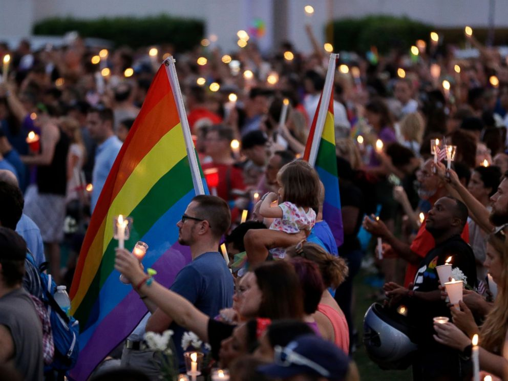 PHOTO: Supporters of the victims of the recent mass shooting at the Pulse nightclub attend a vigil at Lake Eola Park, June 19, 2016, Orlando, Florida. Tens of thousands of people attended the vigil.