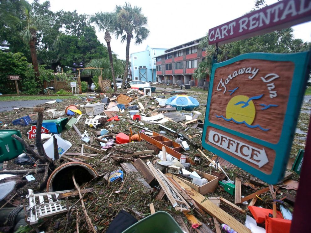 PHOTO: A street is blocked from debris washed up from the tidal surge of Hermine, Sept. 2, 2016, in Cedar Key, Florida.