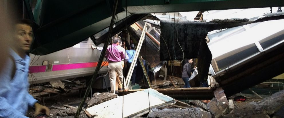 PHOTO: In a photo provided by William Sun, people examine the wreckage of a New Jersey Transit commuter train that crashed into the train station during the morning rush hour in Hoboken, New Jersey, Sept. 29, 2016.