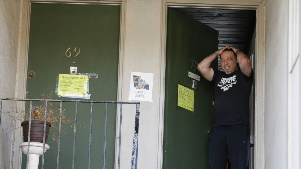 Jonathan Levine stands in his doorway after learning he would have to evacuate his oceanside apartment Jan. 25, 2016, in Pacifica, Calif. His apartment building, perched atop a coastal bluff, is in danger of falling into the ocean.
