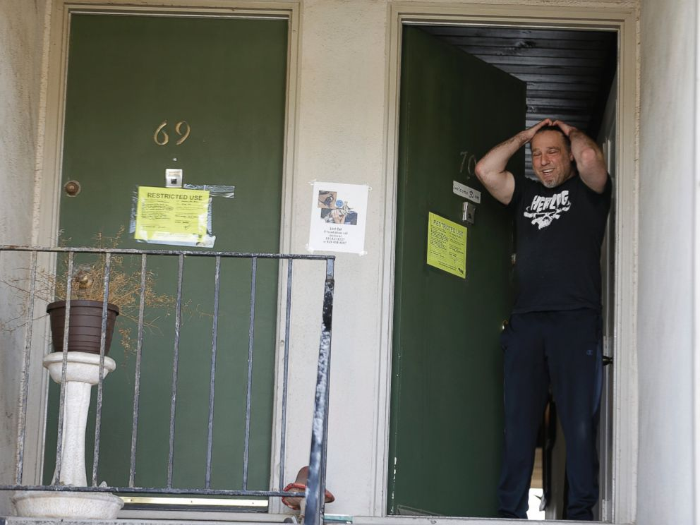 PHOTO: Jonathan Levine stands in his doorway after learning he would have to evacuate his oceanside apartment Jan. 25, 2016, in Pacifica, Calif. His apartment building, perched atop a coastal bluff, is in danger of falling into the ocean.