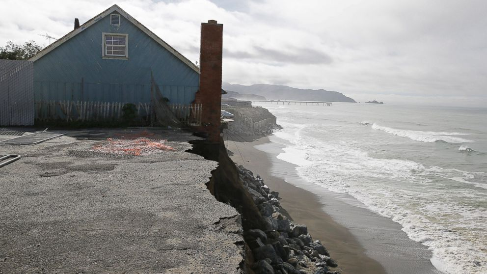 A house stands on the edge of an eroding cliff  with the Pacifica Pier in the background Jan. 25, 2016, in Pacifica, Calif.