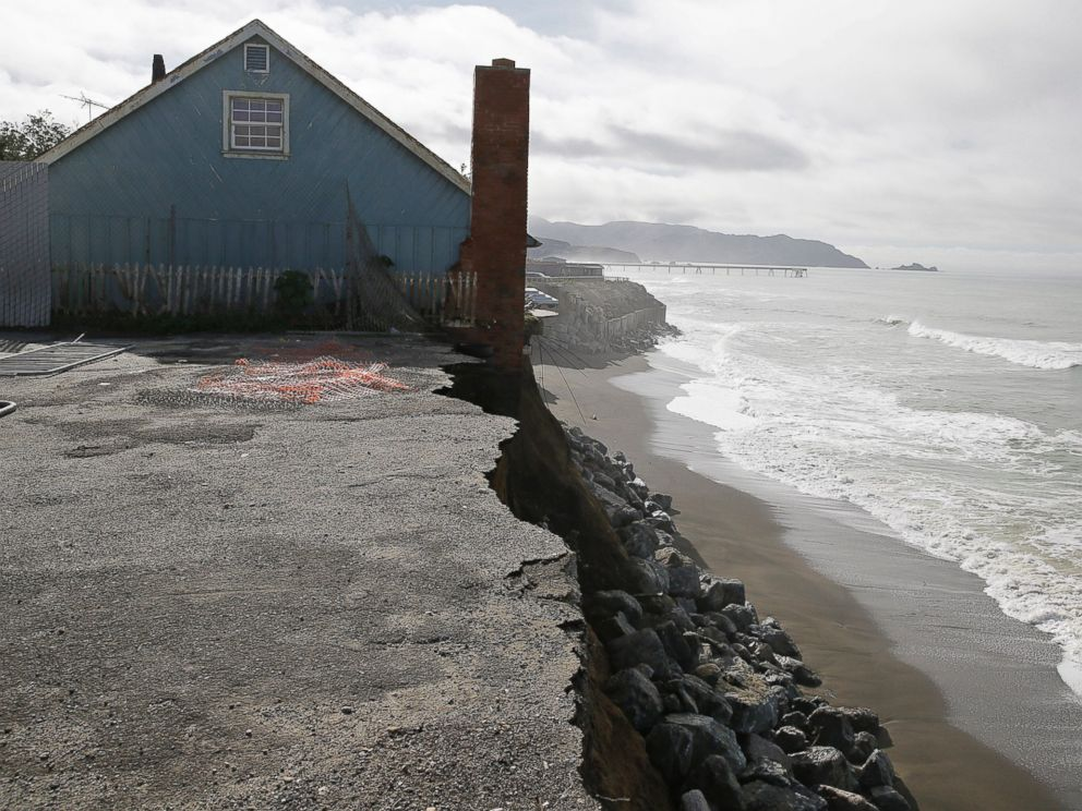 PHOTO: A house stands on the edge of an eroding cliff with the Pacifica Pier in the background Jan. 25, 2016, in Pacifica, Calif.