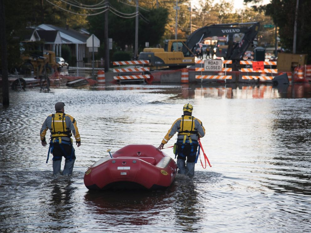 PHOTO: A swift water rescue team down a street covered by floodwaters caused by rain from Hurricane Matthew, on Oct. 10, 2016, in Lumberton, North Carolina.