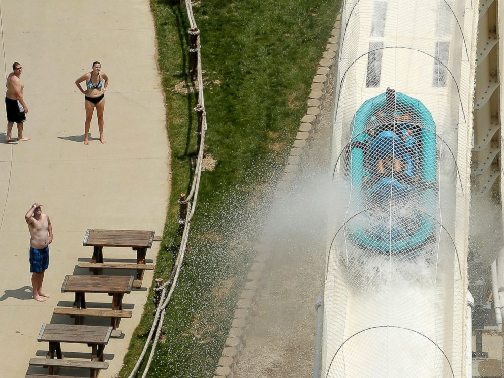 PHOTO: Riders are propelled by jets of water as they go over a hump while riding a water slide called Verruckt at Schlitterbahn Waterpark in Kansas City.