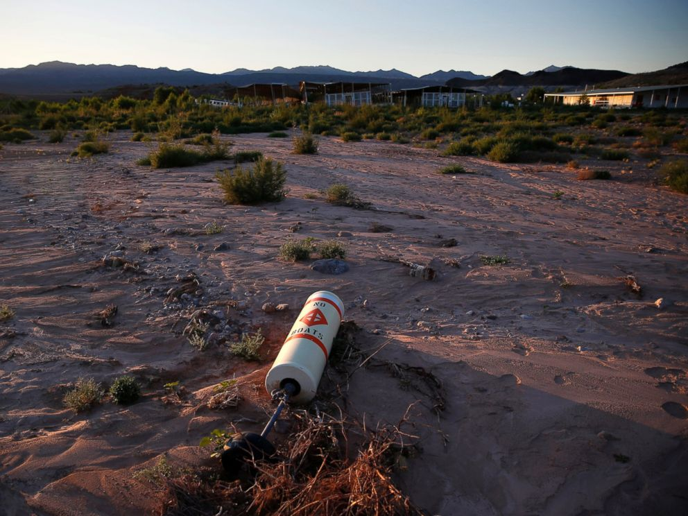 PHOTO: A buoy lies high and dry above the water line at the now defunct Echo Bay Marina in the Lake Mead National Recreation Area, May 19, 2016. Lake Meads surface was at its lowest level Wednesday since the reservoir was created.
