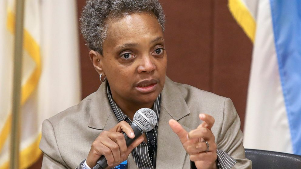 In this March 24, 2019 photo, Chicago mayoral candidate Lori Lightfoot participates in a candidate forum sponsored by One Chicago For All Alliance at Daley College in Chicago. Lightfoot and Toni Preckwinkle, left, are competing to make history by becoming the city's first black, female mayor. On issues their positions are similar. But their resumes are not, and that may make all the difference when voters pick a new mayor on Tuesday.
