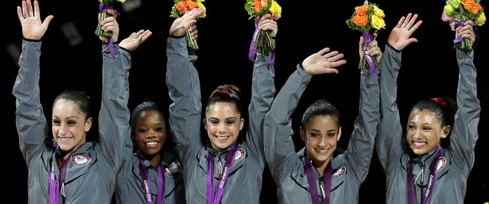 In this July 31, 2012 file photo, McKayla Maroney, center, celebrates on the podium during the medal ceremony for the Artistic Gymnastic womens team final at the 2012 Summer Olympics in London.