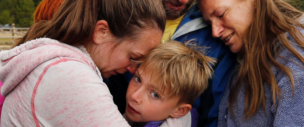 PHOTO: Malachi Bradley, center, is reunited with his family, Aug. 24, 2015, in Uintah County, Utah, after being lost near a remote mountain lake near the Wyoming border on Sunday.