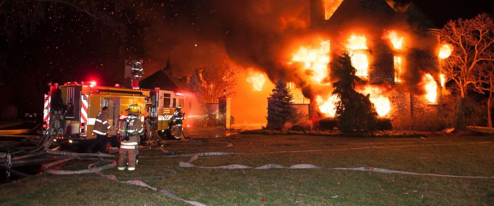 PHOTO: Firefighters battle a four-alarm fire at a home on Childs Point Road, Jan. 19, 2015, in Annapolis, Md.