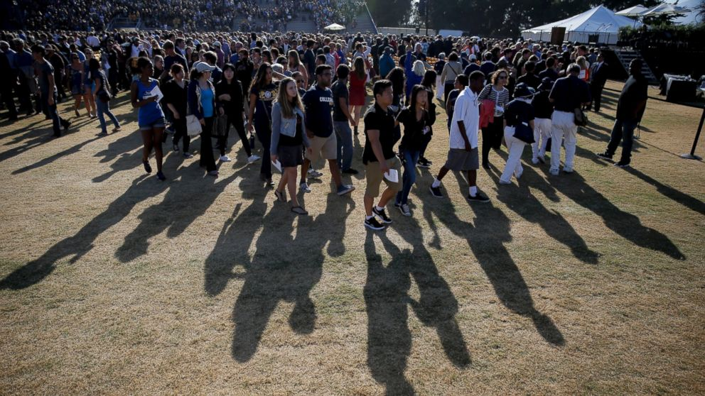The crowd leaves after a memorial service for the victims and families of Friday's rampage at Harder Stadium on the campus of University of California, Santa Barbara, May 27, 2014.