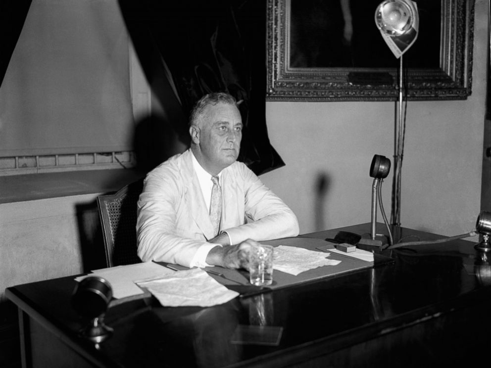 PHOTO: President Franklin D. Roosevelt appeals to the nation via radio for immediate enrollment of all employers under the blanket agreement to raise wages and create jobs, July 24, 1933, in Washington. Within an hour 300 promises had been received.