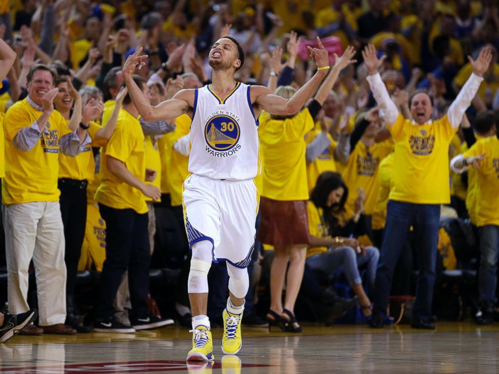 aecdd83fcb4c PHOTO  Fans cheer as Golden State Warriors guard Stephen Curry (30) reacts  after