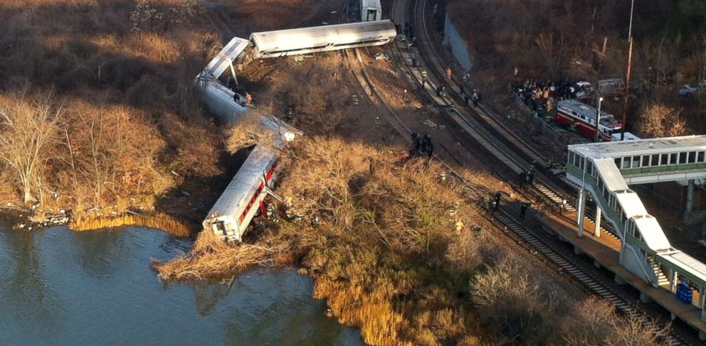 PHOTO: Cars from a Metro-North passenger train are scattered after the train derailed in the Bronx neighborhood of New York, Dec. 1, 2013.
