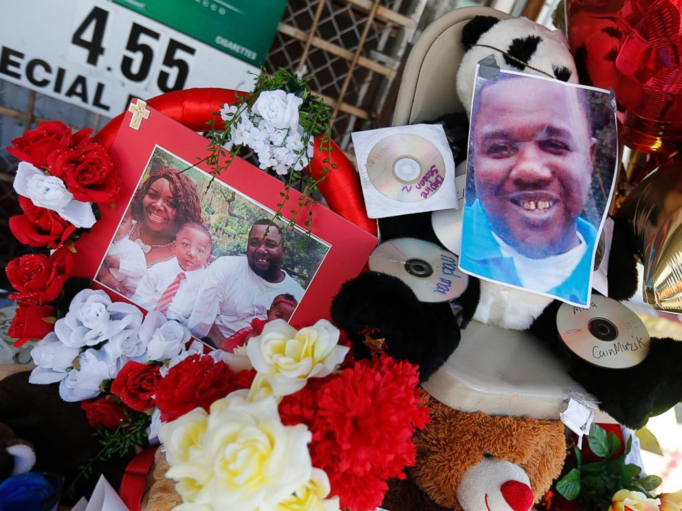 PHOTO: Photos of Alton Sterling are interspersed with flowers and mementos at a makeshift memorial in front of the Triple S Food Mart in Baton Rouge, Louisiana, July 7, 2016.