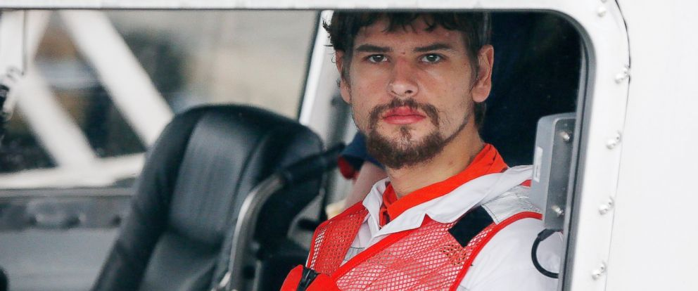PHOTO: Nathan Carman arrives in a small boat at the US Coast Guard station in Boston, on Sept. 27, 2016. Carman spent a week at sea in a life raft before being rescued by a passing freighter.