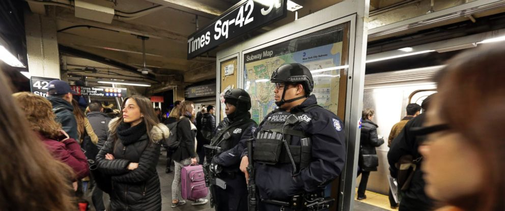PHOTO:New York City Police Department Transit officers patrol a Times Square subway platform, in New York, March 22, 2016.