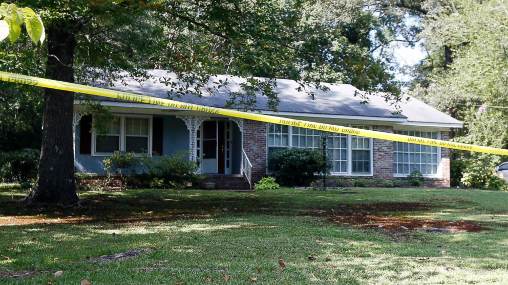 Police crime scene tape surrounds the residence of two Catholic nuns who worked as nurses and helped the poor in rural Mississippi, and were found slain in their Durant, Miss., home on Aug. 25, 2016.