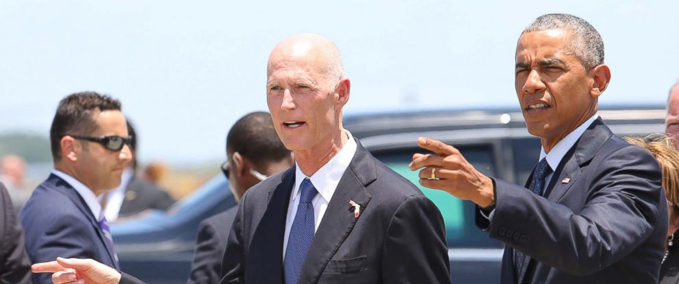 PHOTO: Florida Gov. Rick Scott walks with President Barack Obama on the tarmac during the presidents arrival at Orlando International Airport, June 16, 2016, in Orlando, Fla.