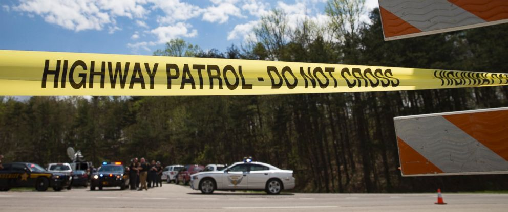 PHOTO: Police tape is deployed across from the Union Hill Road exit off Route 32 at a crime scene perimeter, April 22, 2016, in Pike County, Ohio.