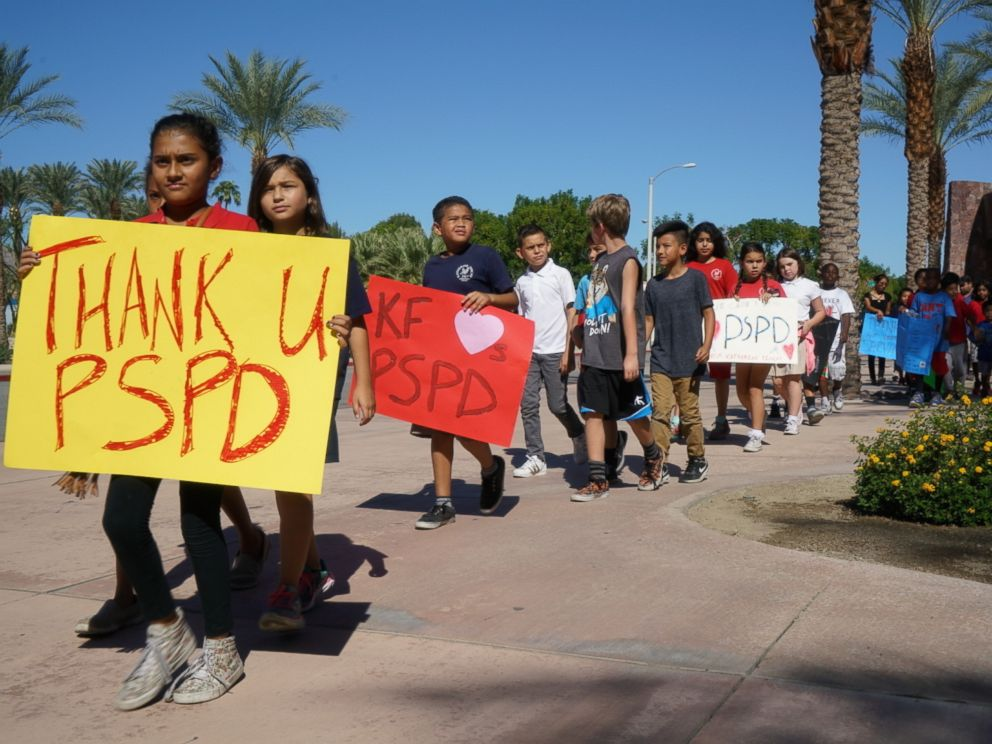 PHOTO: Fourth-graders from Katherine Finchy Elementary School walk outside the Palm Springs Convention Center, showing signs of support for the two fallen police officers, Gil Vega and Lesley Zerebny, on Oct. 18, 2016, in Palm Springs, California.