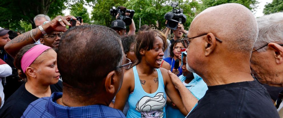 PHOTO: Diamond Reynolds, girlfriend of Philando Castile is consoled after speaking to a crowd outside the governors residence in St. Paul, Minnesota, July 7, 2016.