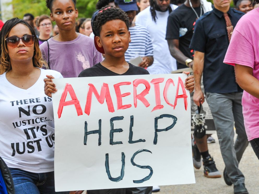 PHOTO: Protesters march to the state Capitol in Baton Rouge, Louisiana, July 10, 2016. People are protesting the shooting death of a black man, Alton Sterling, by two white police officers at a convenience store parking lot last week.