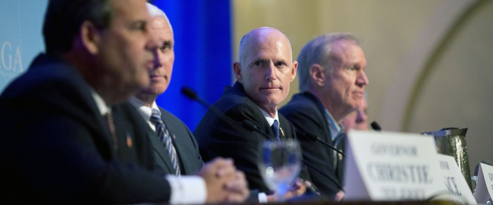 PHOTO: Florida Gov. Rick Scott, center, listens as New Jersey Gov. Chris Christie, left, talks about immigration reform during a press conference at the Republican governors conference in Boca Raton, Fla., Nov. 19, 2014.
