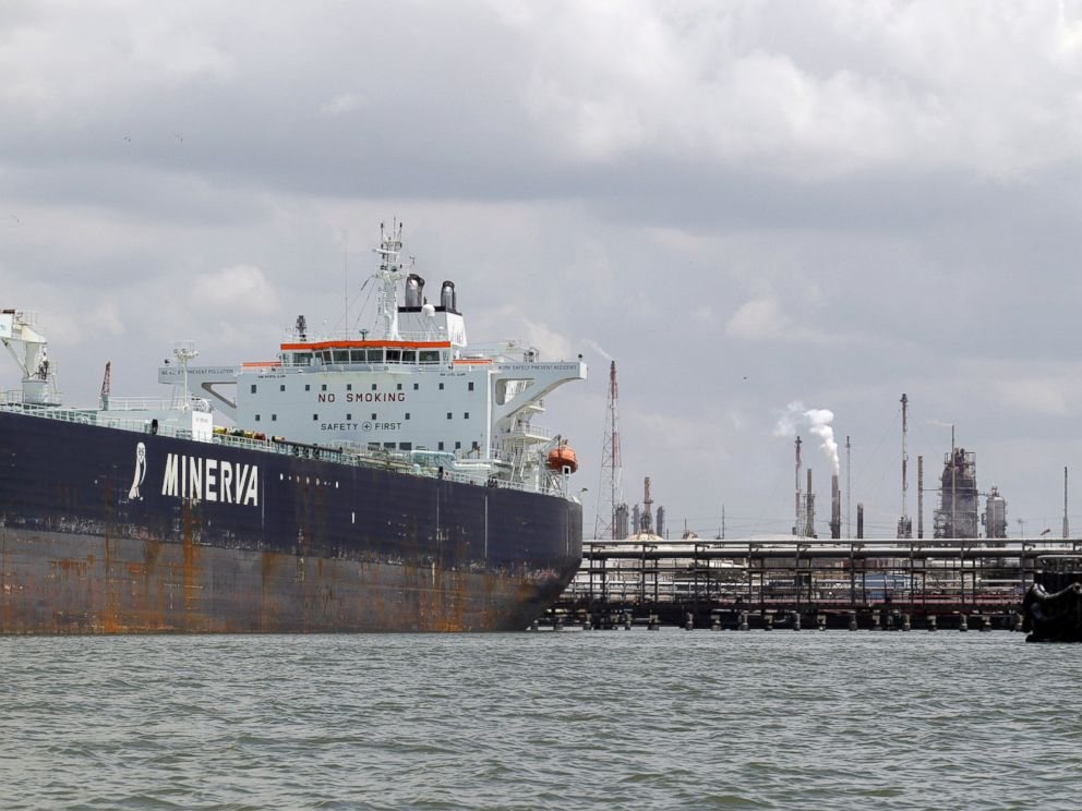PHOTO: An oil tanker is docked at the Exxon Mobile Baytown complex along the Houston Ship Channel, June 2011 in Baytown, Texas.