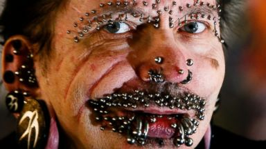 PHOTO: German Rolf Buchholz shows his face with 168 piercings as he visits the 20th Tattoo Convention in Berlin in this file photo, Dec. 4, 2010.