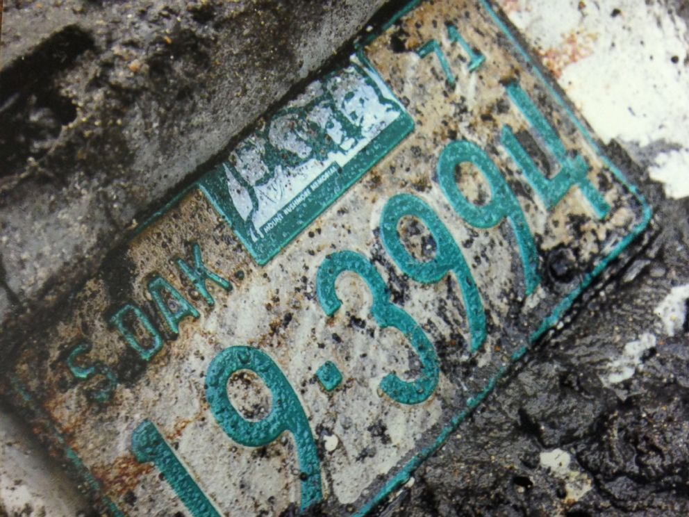 PHOTO: A license plate from the 1960 Studebaker unearthed in September, 2013.