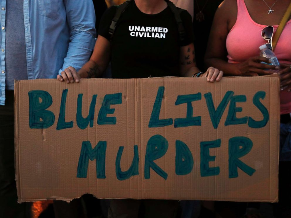 PHOTO: A protester holds a sign while marching in response to a not guilty verdict in the trial of former St. Louis police officer Jason Stockley Saturday, Sept. 16, 2017, in St. Louis.