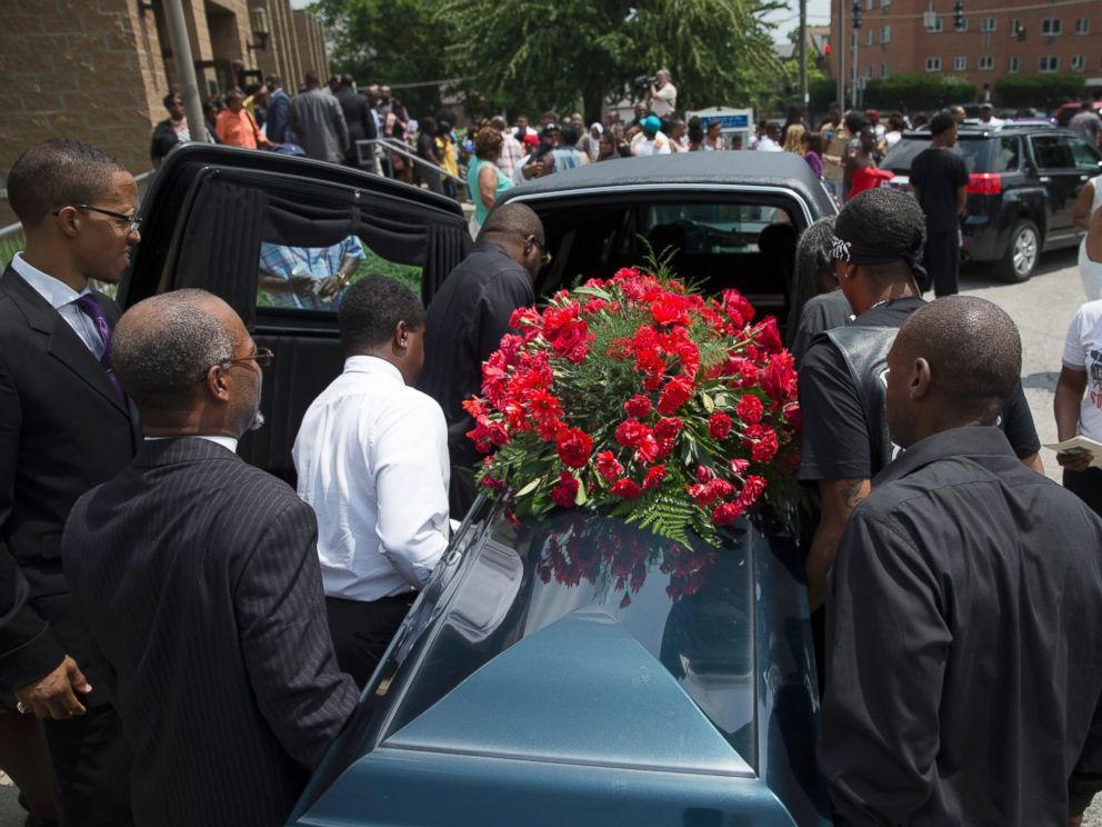 PHOTO: The casket of Samuel Dubose is transported to a hearse during his funeral at the Church of the Living God, July 28, 2015, in the Avondale neighborhood of Cincinnati.