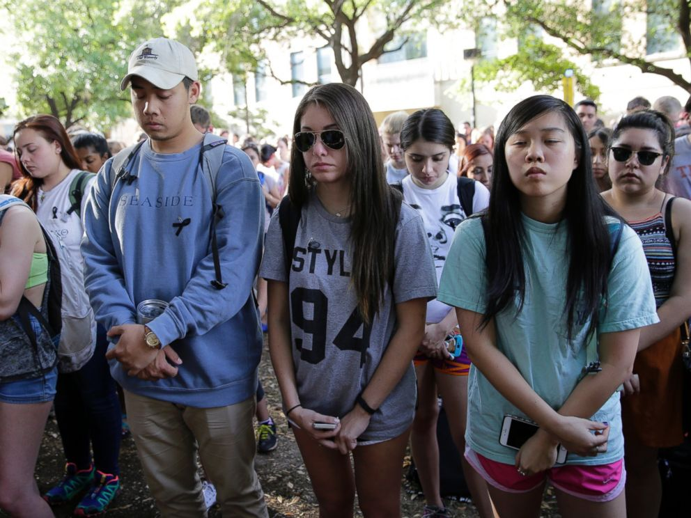 PHOTO: University of Texas students take part in a moment of silence during a gathering for fellow student Haruka Weiser on campus April 7, 2016, in Austin, Texas.