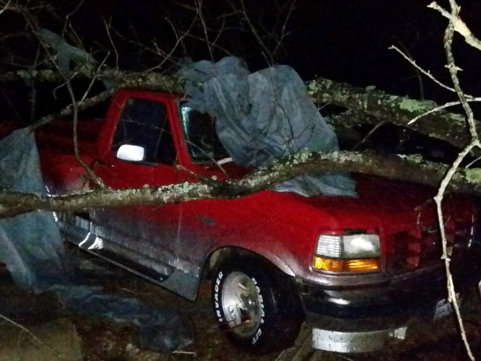 PHOTO: A fallen tree rests atop a pickup truck in Holly Springs, Miss., after a storm struck the town on Dec. 23, 2015.