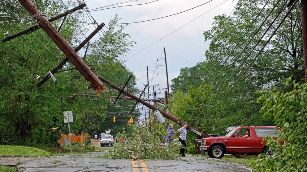Residents survey damage along a street in Tupelo, Miss., April 28, 2014.