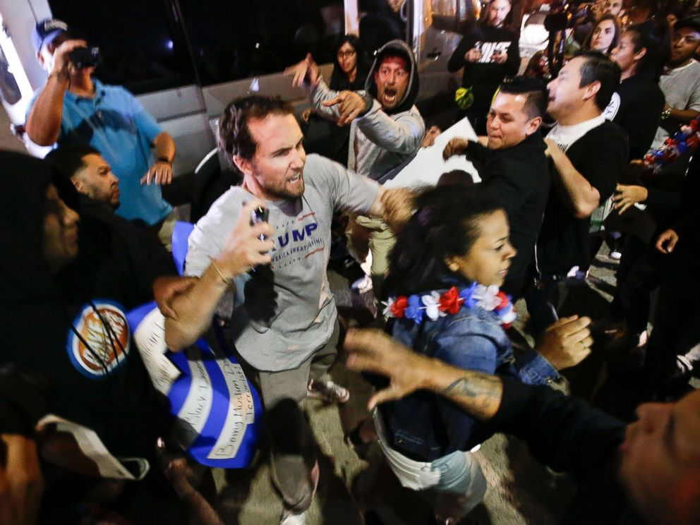 PHOTO: A Trump supporter clashes with protesters outside a rally for Republican presidential candidate Donald Trump, April 28, 2016 in Costa Mesa, California.