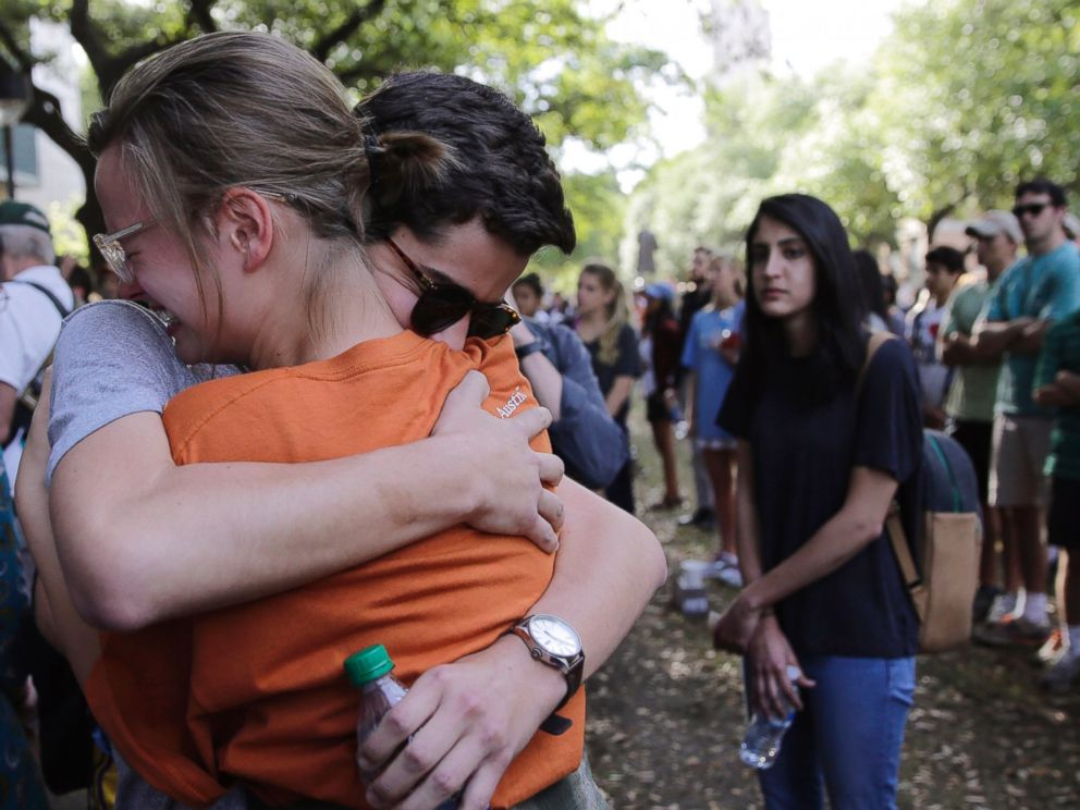 PHOTO: University of Texas students embrace during a gathering for fellow student Haruka Weiser on campus, April 7, 2016, in Austin, Texas.