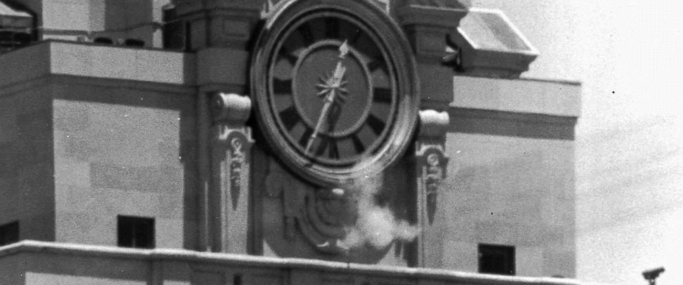 PHOTO: In this Aug. 1, 1966 file photo, smoke rises from the snipers gun as he fired from the tower of the University of Texas administration building in Austin, Texas, on crowds below.