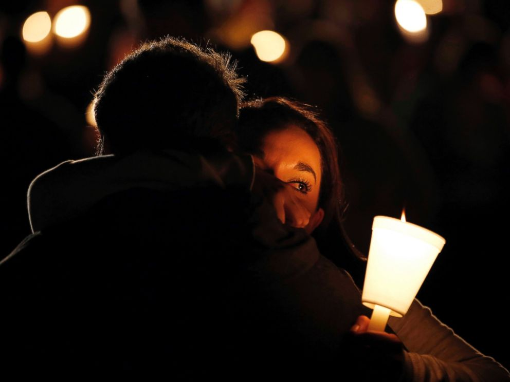 PHOTO: Umpqua Community College student Nichole Zamarripa, right, is consoled during a candle light vigil for those killed during a fatal shooting at the school, Oct. 1, 2015, in Roseburg, Ore.