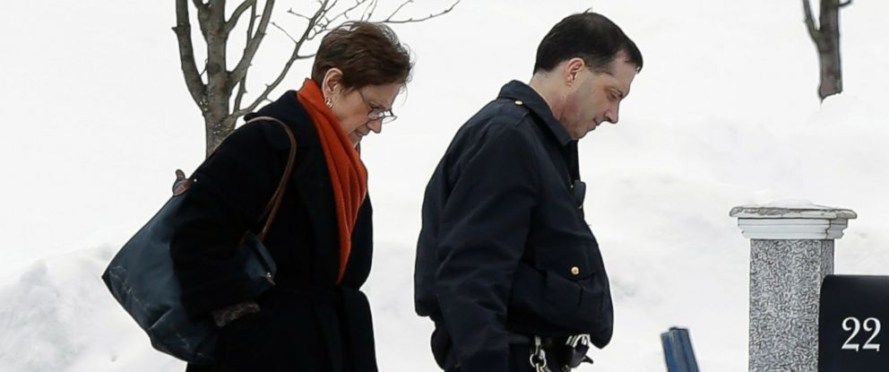 PHOTO: Massachusetts Superior Court judge Susan Garsh, left, and a court officer, right, depart the the North Attleborough, Mass., home of former New England Patriots football player Aaron Hernandez, Feb. 6, 2015.