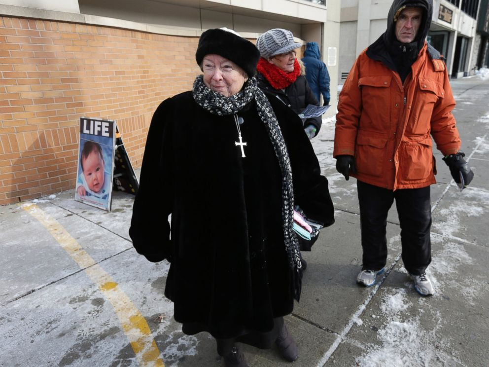 PHOTO: An anti-abortion protester stands at the painted edge of a buffer zone outside a Planned Parenthood location in Boston, Dec. 17, 2013.