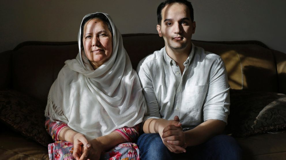 In this Dec. 10, 2014 file photo, Shamim Syed, left, mother of  Adnan Syed and her son Yusef  pose for a photograph in her home  in Baltimore.
