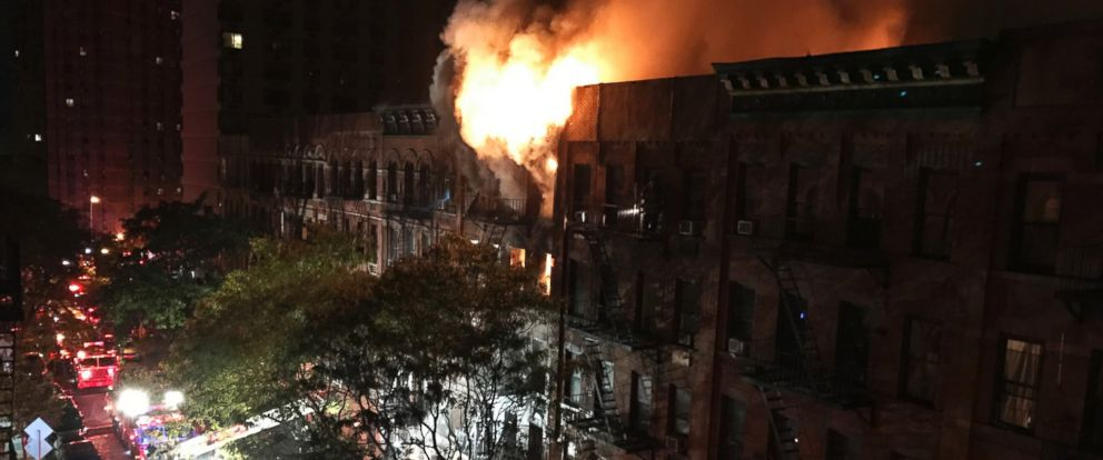 PHOTO: Firefighters work to put out a blaze at an apartment building on the Upper East Side in New York, Oct. 27, 2016.