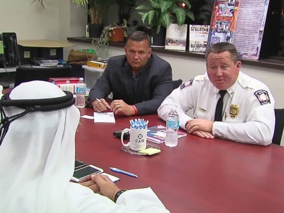 PHOTO: In this July 2, 2016, frame from video, Avon Police Chief Richard Bosley, right, and Mayor Bryan Jensen apologize to Ahmed al-Menhali, after he collapsed following an encounter with police in Avon, Ohio.