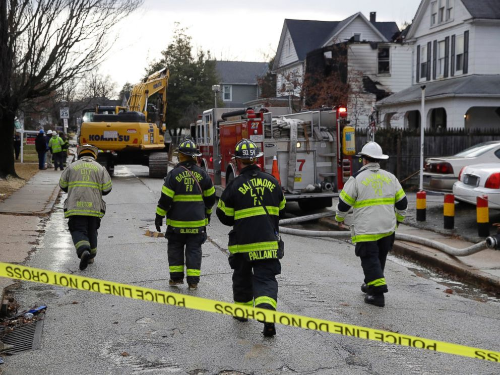 PHOTO: Fire officials approach the scene of an early morning house fire in Baltimore, Jan. 12, 2017.
