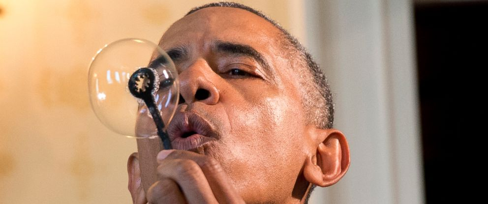 PHOTO: President Barack Obama blows a soap bubble using a 3-D printed bubble wand designed by Jacob Leggette, 9, of Baltimore, Md., while touring the 2016 White House Science Fair at the White House in Washington, April 13, 2016.
