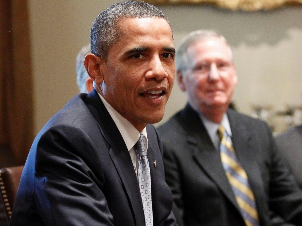 PHOTO: Senate Minority Leader Mitch McConnell of Ky. looks on at right, as President Barack Obama meets with Congressional leaders regarding the debt ceiling, July 13, 2011, in the Cabinet Room of the White House in Washington.